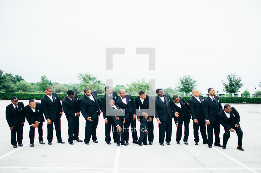 groomsmen and ring bearer in a wedding party