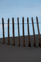 fence line on a beach