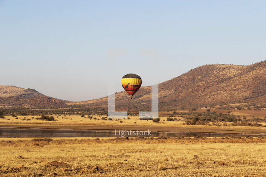 Hot air balloons over the African savanna