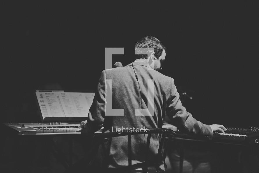 man playing keyboards