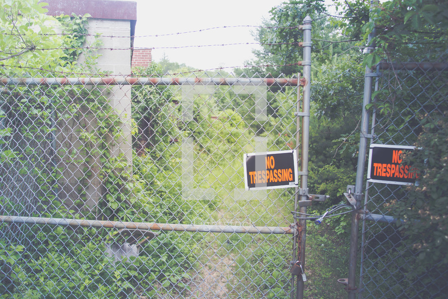 No trespassing sign on a gate