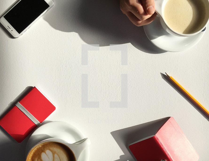 coffee, journals, and Bibles around a table