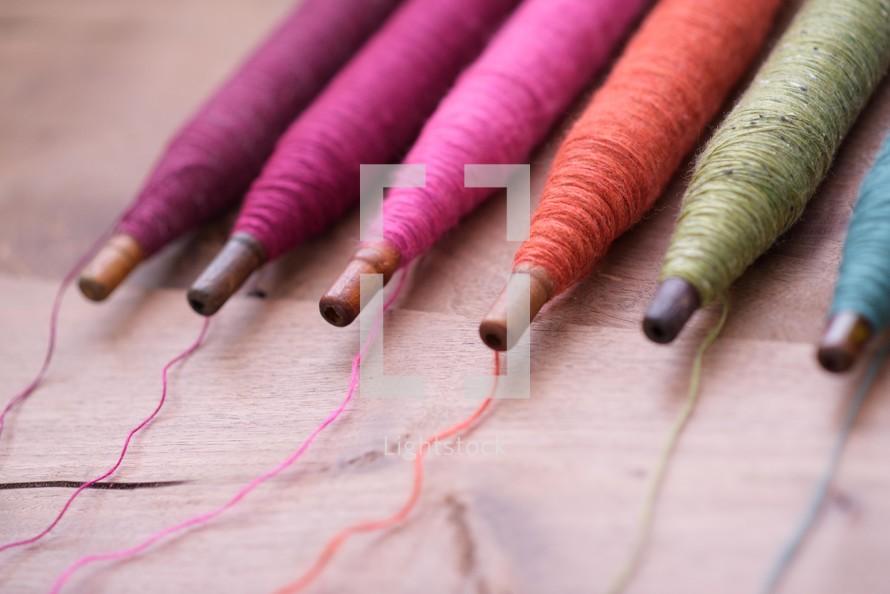 rainbow spools of thread
