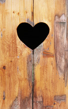 Heart shape cut out in wood background
