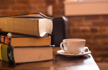 stack of books and a coffee cup