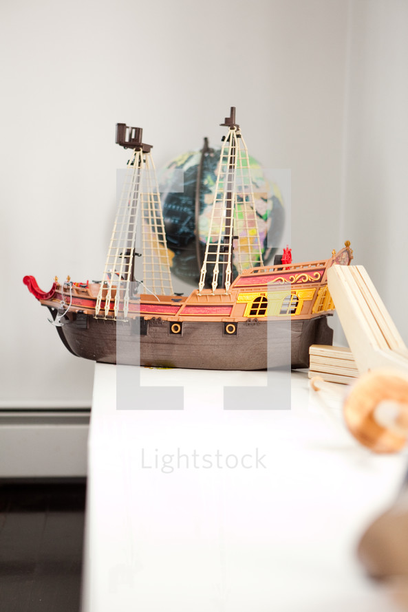 toy ship on a bookshelf
