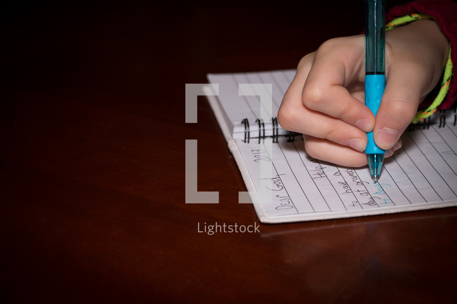 child writing a letter to God
