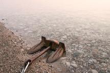 anchor lying on a shore