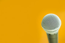 microphone against a yellow background