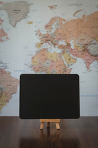 world map and blank sign