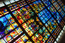 Stained glass church window depicting the fruits from the promised land