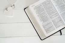 open Bible on a white table