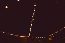 hanging strands of lights in a tent