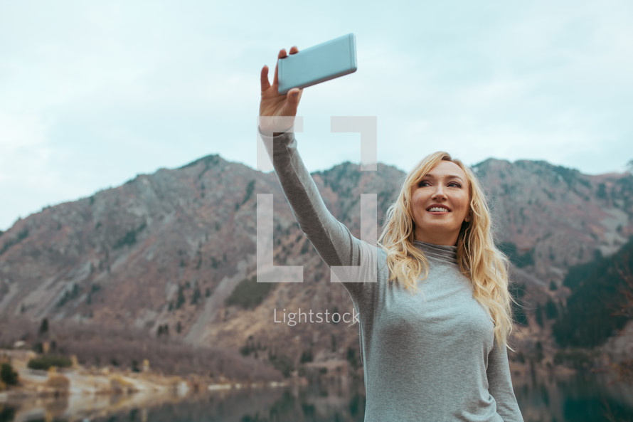 woman talking a selfie outdoors