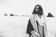Jesus Christ walking in a field