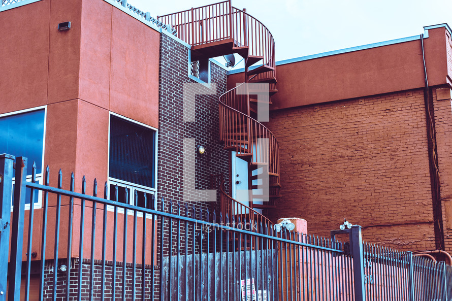spiral staircase on the side of a building