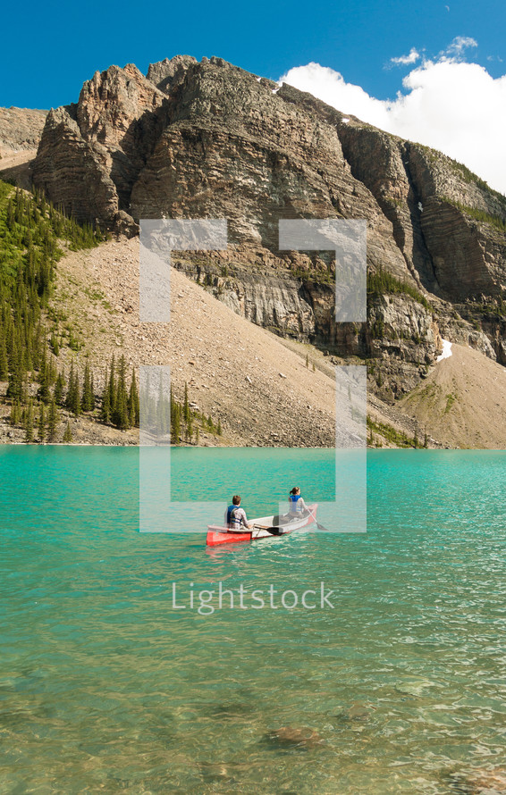 canoe on a mountain lake