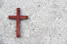 the wooden cross on concrete