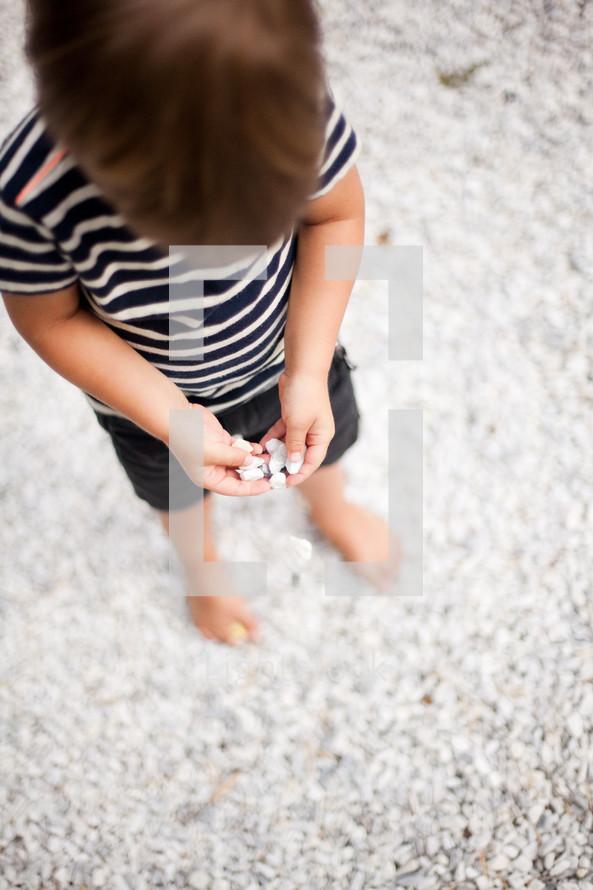 toddler playing in gravel