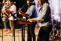 musicians performing on stage during a worship service