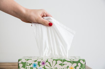woman grabbing a tissue