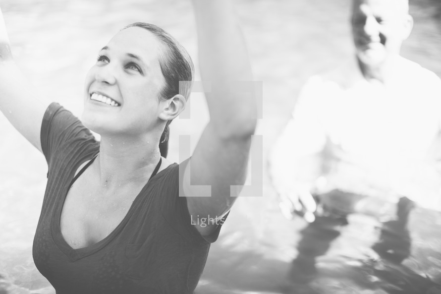 Woman giving praise after her baptism.