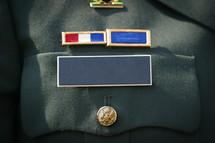 blank military name badge on uniform.