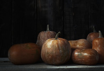 pumpkins and wood background