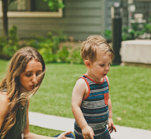 mother and toddler son playing outdoors