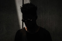 sunglasses, shades, man, standing, head shot, African American, looking down