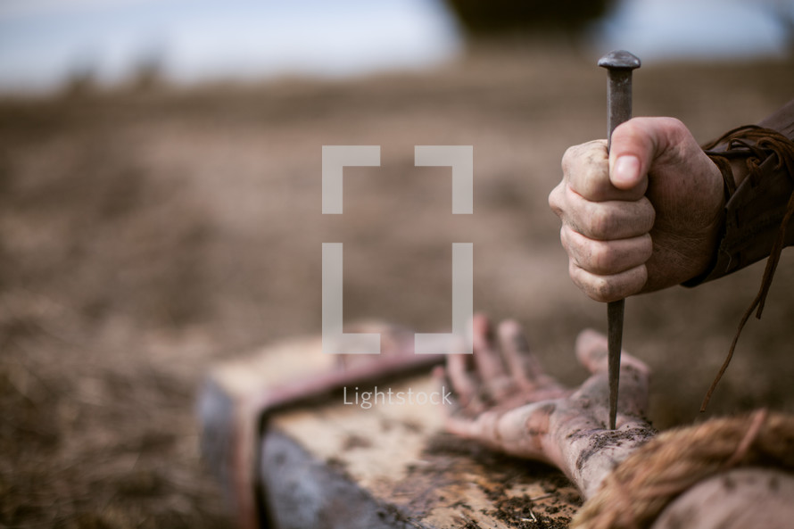 nailing Jesus to the cross