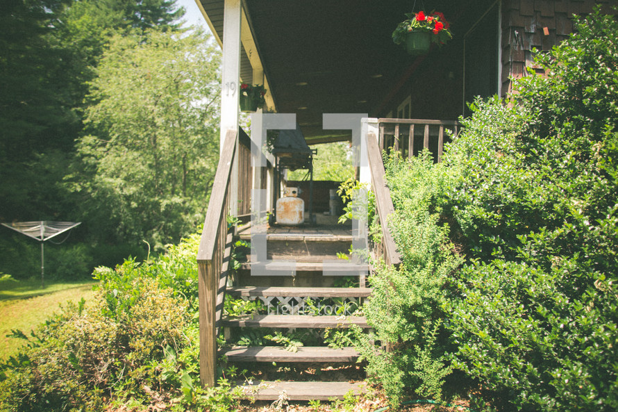 steps on the back porch of a cabin