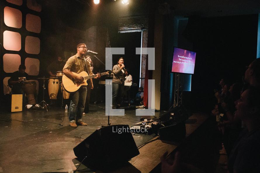 worship music, man, guitar, singing, microphone, musicians