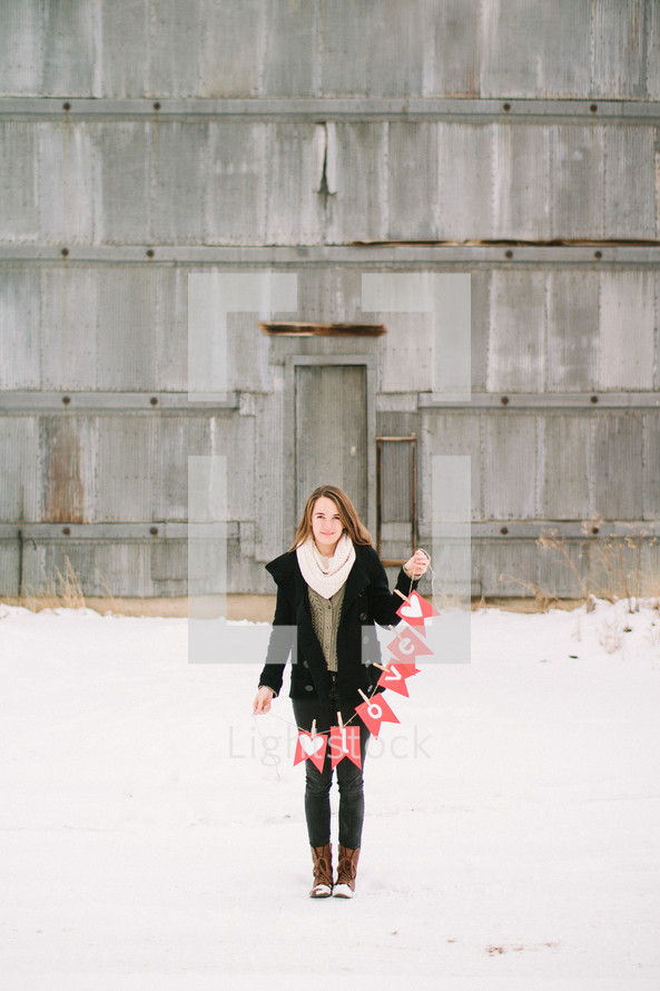 A girl holding a love banner — Photo — Lightstock