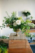 centerpiece floral arrangement on a crate