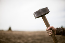 man holding a mallet