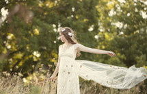 Bride standing in a meadow