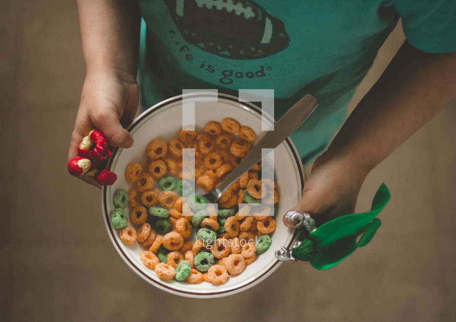 boy child holding a bowl of cereal