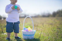 toddler boy and an Easter basket