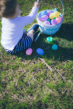 toddler boy playing with an Easter basket