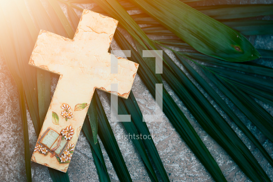 cross on a palm frond