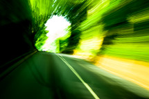 a blur of green light, moving, road, in motion, abstract