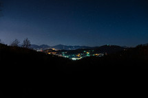Night view of a city in the mountains.