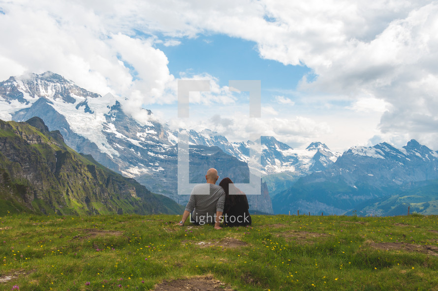 couple sitting on a mountaintop