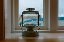 lantern in a window sil