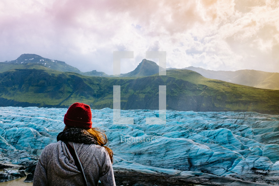 woman exploring a glacier