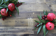 green leaves, pomegranate and cranberries