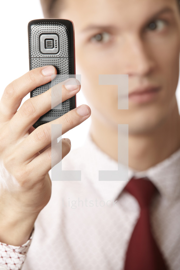 businessman holding a voice recorder