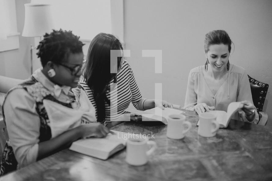 Women's Bible study group reading Bibles