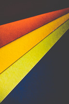 black, red, yellow, orange, papers